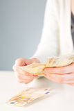 Woman counting money, Euros Royalty Free Stock Photo