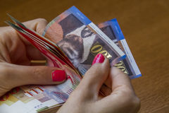 Woman counting money - Israeli New Sheqel banknotes. Stock Image