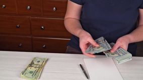Woman counting money,man in business clothes with dollars, Cash in hands. Profits, savings. Stack of dollars. Success. Motivation, financial flows, wealth stock video footage