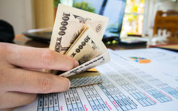 Woman is counting money with statement paper financial concept. Stock Images