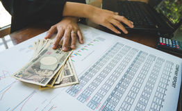 Woman is counting money with statement paper and use computer financial concept. Royalty Free Stock Photography