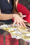 Woman counting money at the table Stock Photography
