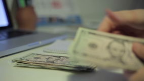 Woman counting money stock video footage