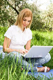 Woman in country with laptop Royalty Free Stock Photo
