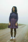 Woman, country road in fog Royalty Free Stock Photography