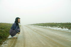 Woman, country road in fog Stock Images