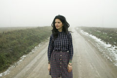 Woman, country road in fog Royalty Free Stock Photos