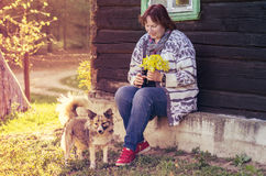 Woman in countryside near house with dogs Stock Photos