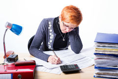 Woman counts taxes. On a white background Stock Photo
