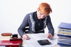 Woman counts taxes Stock Photos