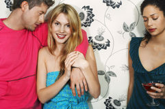 Woman With Couple By Floral Print Wall Royalty Free Stock Image