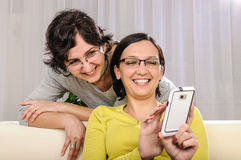 Woman couple selfie smart phone Stock Image