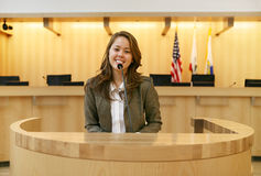 Woman in Court. A pretty young woman testifying in court Royalty Free Stock Photos