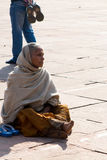 Woman in courtyard at the Great Mosque (Jama Masjid) in Delhi, India. Woman sitting in the courtyard at the Great Mosque (Jama Masjid royalty free stock photos