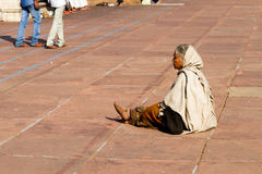 Woman in courtyard at the Great Mosque (Jama Masjid) in Delhi, India. Woman sitting in the courtyard at the Great Mosque (Jama Masjid stock image