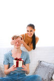 Woman cover eyes to waiting present boyfriend Royalty Free Stock Image