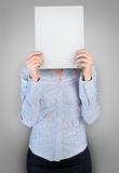 Woman cover face with board Royalty Free Stock Image