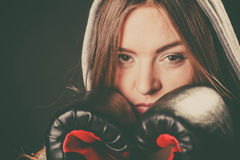 Woman cover face with boxing gloves. Fighting boxing and defense. Sportsmanship and strong body. Young woman wear sportswear and boxing gloves cover face look royalty free stock image