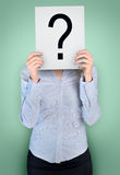 Woman cover face with question board Stock Images