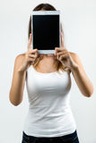 Woman cover her face with digital tablet. Isolated on white. Portrait of woman cover her face with digital tablet. Isolated on white Royalty Free Stock Photos