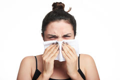 Woman cover her face with tissue Royalty Free Stock Image
