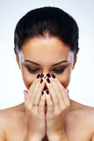 Woman cover her mouth by hands Royalty Free Stock Images