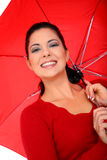 Woman Cover With Umbrella. Attractive young woman posing with umbrella on white background royalty free stock image