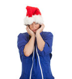 Woman in coveralls and Santa hat with pain Royalty Free Stock Images
