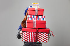 Woman Covered by Carried Gift Boxes Stock Images