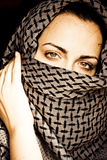 Woman with covered face Royalty Free Stock Photography