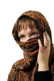 Woman with a covered face Stock Images