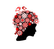 Woman covered with flowers and birds Stock Images