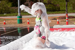 Woman Covered In Foam At Crazy Obstacle Course Race Stock Photos