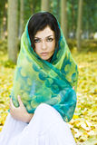 Woman covered by headscarf. Stock Photography