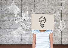 Woman covered her face with a cardboard box showing light bulb. Digital composition of woman covered her face with a cardboard box showing light bulb and Royalty Free Stock Photo