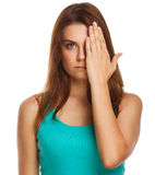 Woman covered her face half hand isolated Stock Image