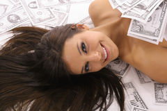 Woman covered in money. Shot of a woman covered in money Stock Images