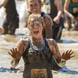 Woman covered in mud making a face Royalty Free Stock Photography