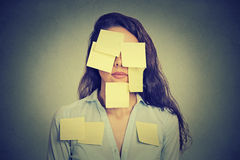Woman covered in notes Royalty Free Stock Image