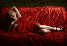 Woman covered with red silk sheet Royalty Free Stock Photo