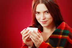 Woman covered with woolen plaid Royalty Free Stock Image
