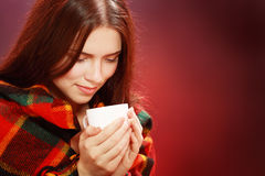 Woman covered with woolen plaid Royalty Free Stock Photography