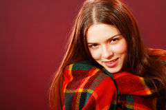 Woman covered with woolen plaid Stock Photography