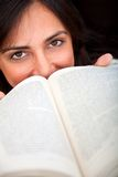 Woman covering with a book Royalty Free Stock Images