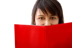 Woman covering with a book Royalty Free Stock Image