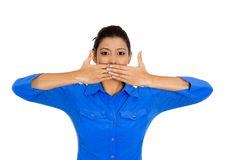 Woman covering closed mouth Stock Image