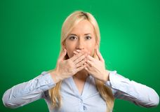 Woman covering closed mouth with hands Royalty Free Stock Photos