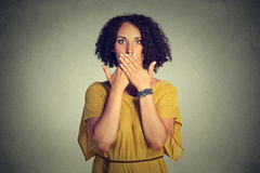 Woman covering closed mouth with hands. Speak no evil concept Royalty Free Stock Images