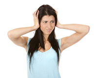 Woman covering ears Stock Photo