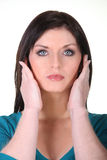 Woman covering ears Royalty Free Stock Photos